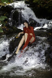 Girl in a waterfall Stock Photo