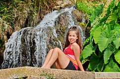 Girl and waterfall in Israel Royalty Free Stock Photo