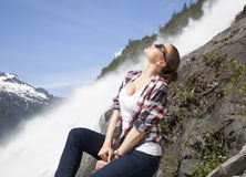 Girl By The Waterfall Royalty Free Stock Photo