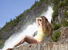 Girl By The Waterfall Royalty Free Stock Image