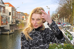 Girl on the waterfront in the Dutch town of Gorinchem. Stock Image
