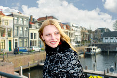 Girl on the waterfront in the Dutch town of Gorinchem. Royalty Free Stock Image