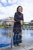 Girl on waterfront in Dutch town of Haarlem,. Girl on the waterfront in the Dutch town of Haarlem, the Netherlands Royalty Free Stock Image