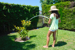 Girl watering Stock Photo