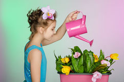 Girl watering  beautiful flowers Stock Photo