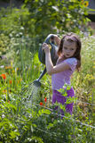 Girl With Watering Can Stock Photography