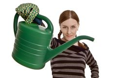 Girl with watering can. Girl with green watering can Royalty Free Stock Photos