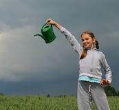 Girl with watering-can Royalty Free Stock Photos