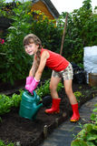 Girl with watering can Royalty Free Stock Image