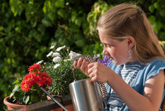 Girl watering flowers Royalty Free Stock Photography