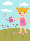 Girl watering flowers Stock Images