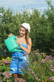 Girl is watering the flowers royalty free stock image