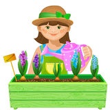 Girl watering flowers Stock Photography