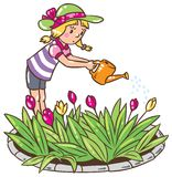 Girl watering the flowers Stock Photography