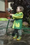 Girl watering the garden Stock Photography