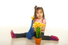 Girl watering plant Royalty Free Stock Photo