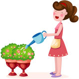 Girl watering plant Stock Photography