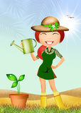 Girl watering the plant Royalty Free Stock Images