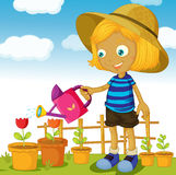 A girl watering plants Stock Photo