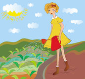 Girl watering young crops. At the field Royalty Free Stock Photo