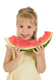 A girl with watermelon. Little funny girl eating a watermelon. Healthy Eating stock image