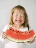 Girl and Watermelon Stock Images