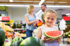 Girl with watermelon in fruit section Stock Photos