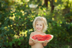 Girl with watermelon. In the garden royalty free stock photos