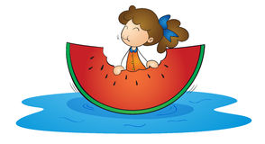 Girl and watermelon Stock Image