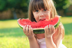 Girl and watermelon Stock Photography