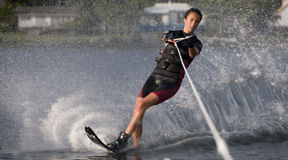Girl Waterskier. Teenage girl on a slalom (single) waterski Stock Photography