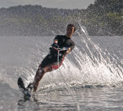 Girl Waterskier. Teenage girl on a slalom (single) waterski Royalty Free Stock Image