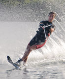 Girl Waterskier. Teenage girl on a slalom (single) waterski Stock Images