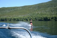 Girl waterskiing on a beautiful lake Royalty Free Stock Images
