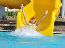 The girl on a waterslide. In an aquapark Royalty Free Stock Photo
