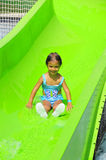 Girl on waterslide Stock Images