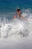 Girl in waves. Teenage girl playing in waves Royalty Free Stock Photos