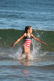 Girl and Waves. A young girl enjoying the waves at the ocean Royalty Free Stock Photo
