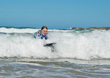 Girl in the waves Royalty Free Stock Photo