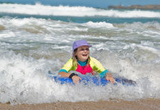 Girl in the waves Royalty Free Stock Image