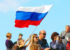 A girl waves Russian state flag. MOSCOW REGION - SEPTEMBER 07, 2014: A girl waves Russian state flag. People greet participants of Borodino battle historical stock images