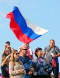 A girl waves Russian state flag. MOSCOW REGION - SEPTEMBER 07, 2014: A girl waves Russian state flag. People greet participants of Borodino battle historical stock photography