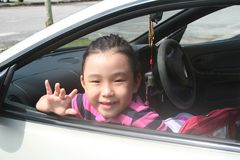 Girl waving. Girl smiling and waving in the car ready for outing Stock Photos