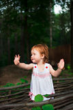 Girl waving hands royalty free stock photography