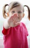 Girl waving hello Stock Photography