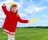 Girl waving maple leaves Stock Photos