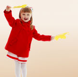 Girl waving maple leaves Royalty Free Stock Photos