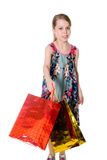 Girl waving a shopping bag. Stock Images