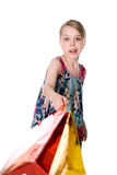 Girl waving a shopping bag. Royalty Free Stock Images