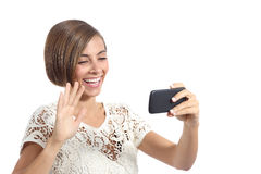 Girl waving on the smart phone while during a video call Royalty Free Stock Image